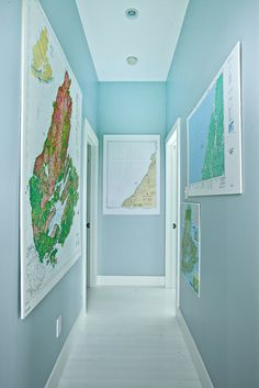 maps down hallway idea in action. are they on foam board? might be a good way to hang/display