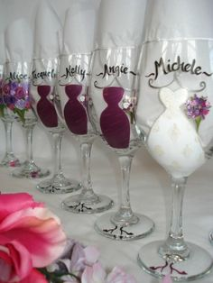 Wedding party simply painted wine glasses, maybe a cute anniversary gift and thank you for being a part of the wedding party?