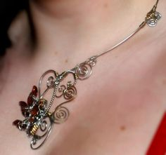 Necklace by Michaela Nastasia - Sterling silver and bronze wire with Swarovski crystal.