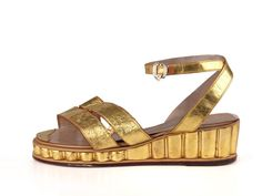 Shoe-Icons / Shoes / Gold leather wedge shoes with double straps with embossed images.