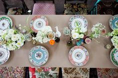 Setting the table with mismatched china.
