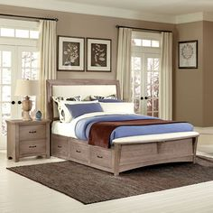 I like the additional bench at the foot of the bed....Chambers Queen Upholstered Storage Bench Bed