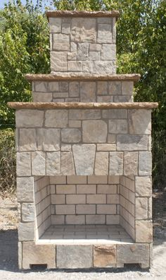 """Stone Age New Age™ 39"""" outdoor fireplace in natural thin stone.  This unit is prebuilt and can be shipped and set into place in the backyard, and is also available in kit form."""
