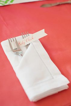 Place settings and name cards used to add color to the table.