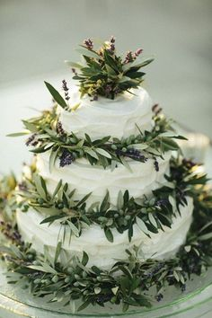 A #Mediterranean themed #wedding #cake, with #lavander and #olive leaves, perfect for a #wedding in #Sicily bebtrapanilveliero.it