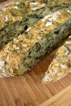 Spinach Feta Bread: 1 box (10 oz) chopped frozen spinach, thawed and drained, 1/2 cups lukewarm water, 2 1/4 tsp active dry yeast, 1 1/2 tsp salt, 1/3 cup crumbled feta cheese, 2 1/4 tsp sugar, 3 1/4 cups all purpose flour