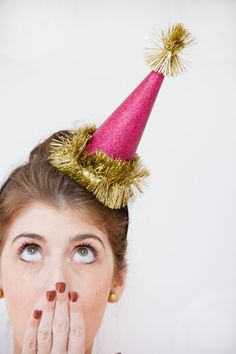 DIY Christmas Party Hats - Um I love the idea of these to wear at next year's craft party, with over the top girly decorations.