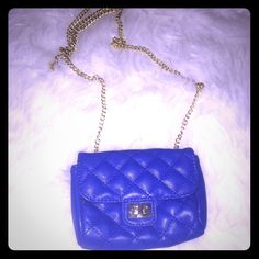 NEW Small Blue Purse with Chain Strap This is an adorable blue purse with a gold chain strap.It will fit your essentials and will become a favorite. NWOT and never used. Purchase for yourself or as a gift. 🎁🎉💅🏾👠💄OFFERS ACCEPTED. Bags Mini Bags