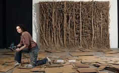 Eva Jospin; Makes beautiful forests out of cardboard.