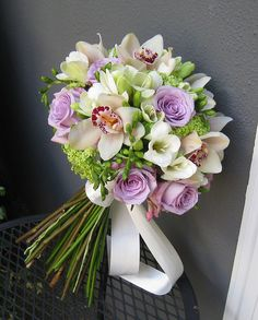Designs by Courtney Wedding and Event Floral Design - Bothell, WA, United States. Bridal bouquet with lavender roses, orchids, white freesia and viburnium Purple Wedding Bouquets, Spring Wedding Colors, Rose Wedding Bouquet, Bride Bouquets, Bridal Flowers, Floral Bouquets, Send Flowers, Bridesmaid Bouquet, Arte Floral