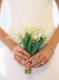 Simple and sweet Lily of the Valley bouquet | Photography: Karen Hill Photography - karenhill.com Read More: http://www.stylemepretty.com/2015/05/27/elegant-nyc-wedding-at-the-high-line-hotel/