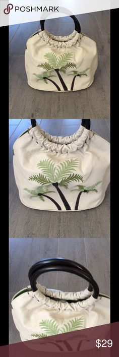 Coke Haan Leather Palm Tree Handbag Cole Hahn ivory leather purse with brown wooden brown handles and palm trees Embroidered on the front of the bag it's a small bucket bag the lining is like new excellent condition as well as the bottom bucket part of the bag it's like new excellent condition would look great with a Tommy Bahama style dress. Cole Haan Bags Totes