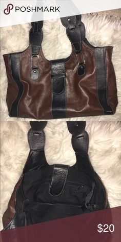 Handcrafted soft leather bag from Honduras Purchased at a market in Honduras this super soft hand crafted bag is perfect for any occasion! The black and brown matches everything and it fits a ton of stuff! Bags Shoulder Bags