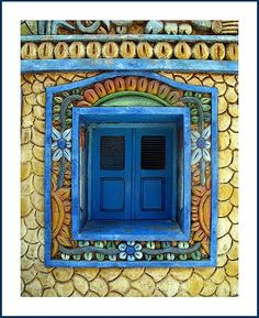 Blue window with lovely mosaic surround