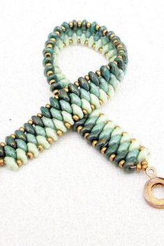 A jade superduo beaded bracelet that is beautiful and unique. This bracelet has the ombre look with different shades of jade. It has a boho vibe. It can be worn all by itself for a unique look or stacked with other bracelets. It fits a 7 1/2 wrist. Gold snap clasp. Treat yourself.
