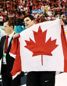 Sidney Crosby is obviously hiding something behind that flag.