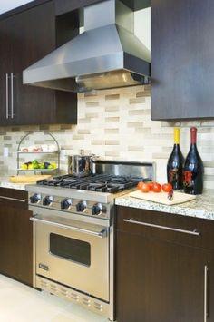 Nuetral Tile backsplash + modern dark cabinets + light granite countertops