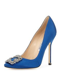 """Manolo Blahnik """"Hangisi"""" satin evening pump. 4.5"""" covered stiletto heel. Crystal buckle adorns pointed toe. Low-cut vamp visually lengthens leg. Topstitched collar. Leather lining and sole. Slip-on st"""