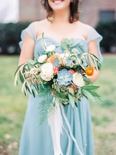 Lush bridesmaid bouquet with roses and succulents! Photo: Callie Davis of Nancy Ray Photography / Floral Design: Simply Elegant Floral Designs | Snippet & Ink