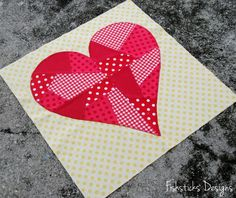 My February Heart Block finished!  Used the blanket stitch on my sewing machine to applique the heart to the background.