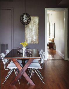 This home is a great example of how one can do a modern interior and still keep it warm. All of the lovely, dark hardwoods keep it cozy, but the hard edges and careful editing keep it very zen. What do you think? Amazing window! Love their entryway A farmhouse table mixed with modern chairs …