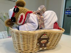 Sock Monkey Diaper Baby Basket! Perfect for a baby shower gift, a baby shower centerpiece, a hospital gift or nursery decor. Want to customize or personalize your gift? Ask us how! Now offering hospital delivery! www.everythingandthebaby.com