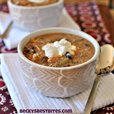 "Even if the weather isn't cold, this soup still warms the soul.  This Skinny Slow Cooker Chicken Enchilada Soup has all the flavor of that comfort food favorite but none of the guilt! Thanks to a ""secret"" ingredient, you will still get a nice creamy feel that propel you back to the kitchen for a second helping! Don't feel guilty about it…"