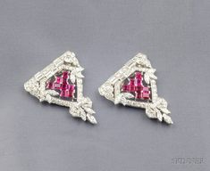 Art Deco Platinum, Ruby, and Diamond Dress Clips, set with square-cut rubies, and marquise-cut diamond foliate motifs, further-set with old European, full, single, and baguette-cut diamonds, approx. total diamond wt. 7.26 cts., with frame for brooch conversion, each lg. 1 1/2 in