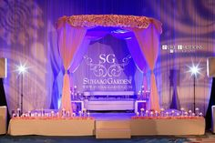 Suhaag Garden, Indian Wedding Decorators, Florida Wedding Decorators, Reception Stage, Blush Pink Canopy, Blush Pink Chuppah, River of Candles, White Leather Seating