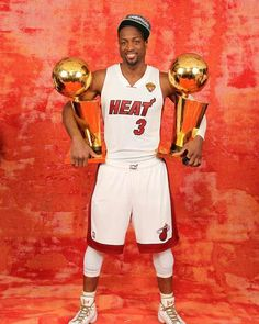 Dwyane Wade of the Miami Heat poses for a portrait with both Larry O'Brien Trophies after winning the Championship against the Oklahoma City Thunder - http://www.fansedge.com/Dwyane-Wade-Miami-Heat-NBA-Finals-Game-5-6212012-_-820726167_PD.html?social=pinterest_nbafinals_wade