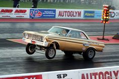 Nostalgia Gasser Dragster | Nic Williams pulls a wheelie in his beautiful Ford Falcon