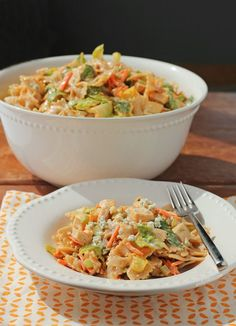 This Buffalo Chicken Pasta Salad is a creamy, spicy, lightened up twist on pasta salad that tastes amazing and is perfect for lunch or your next potluck! Just 297 calories or 7 Weight Watchers points per serving. www.emilybites.com