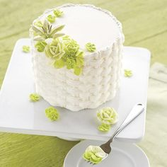 Floral Basketweave Cake - Lovely blooms in soft shades of green sit prettily atop a cake decorated using the basketweave icing technique. Serve this cake for Mother's Day or any spring or summertime celebration. Learn how to pipe a basketweave and other great decorating techniques by signing up for The Wilton Method of Cake Decorating Course 2.