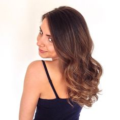 Brunette hair with a soft ombre, sombre or ombre. Sexy waves.