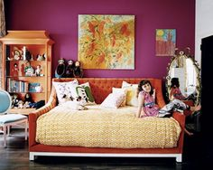 We work with plenty of clients who live in studio spaces where living room, bedroom, and kitchen are one. One approach to make a bed appear more couch-like than bed-like is to place it along a wall and shower the long side of the bed with throw pillows, but let's face it, it still usually looks like a bed. So our heart skipped a beat when we spotted this dreamy, full or queen size custom upholstered daybed in Elle Decor...