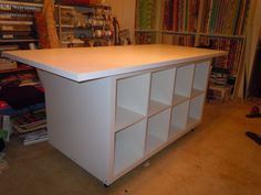 Sewing table on wheels, like it!