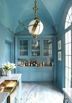 Miles Redd bar area with blue everything and vaulted gothic ceiling, zodiac pendant light, marble countertop.  So pretty.
