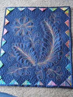 Embellished feathers on silk taffeta using King Tut's variegated thread. The Nifty Stitcher: Free Motion Quilting