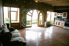 "Earthship! Complete with thermal/solar heating & AC, solar & wind energy, contained sewage treatment, natural water harvesting, indoor & outdoor food production, and is built out of natural and recycled materials. Making it possible to comfortably live completely ""Off-the-Grid"" I'll take it!"