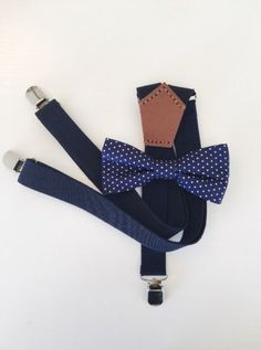 One size fits all elasticated clip on suspenders finished with a hand sewn genuine leather y-back trim. Paired with a men's size bow tie , fitted with a co Polka Dot Bow Tie, Suspenders, Real Weddings, Hand Sewing, Pairs, Bows, Navy, Leather, Men