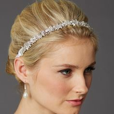 Clusters of genuine crystals are hand-wired to a silver headband creating a stunning bridal headpiece. Glistening with dainty pave leaves, the slender silhouette of this vintage wedding headband adds understated glam to any bridal hairstyle. 9 3/4