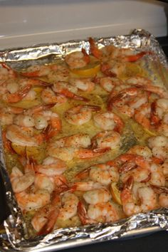 shrimp scampi just out of the oven 2 pounds shrimp (thawed, if frozen) 1 stick of butter 1 packet Italian dressing seasoning 1 lemon, sliced