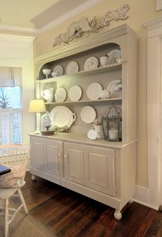 I have a hutch I am redoing...I think I LOVE the round legs on the bottom of this one and I am going to do the same to mine...already adding crown molding at the top :)