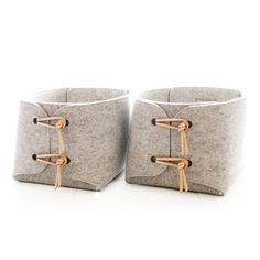 storage baskets with natural leather details - Two large storage baskets - storage bins - storage box - minimalist felt laundry hampers by SKANDINAVIOUS on Etsy https://www.etsy.com/listing/249491841/storage-baskets-with-natural-leather