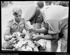 This is a picture of a few soilders taking care of an injured child, this picture shows how troops cared about each other and the people around them, and how they would of been impacted.