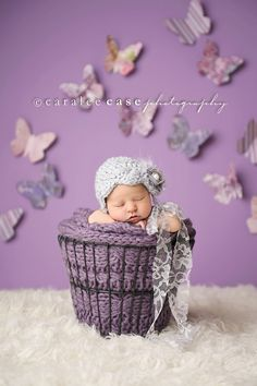 Like the background, and how it is just that and the floor - no baseboard. Beautiful props too.    Caralee Case Photography