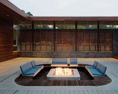 """""""We didn't want the pit to be an obtrusive contraption sitting in the center of a zen-like courtyard,"""" says architect Matthew Hufft. A low-profile fire pit is the perfect continuation of a mellow Missouri backyard. Photo by Mike Sinclair."""