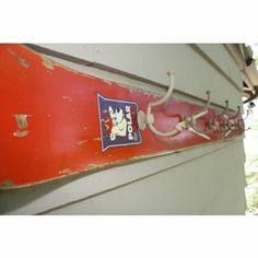sunroom-Water Ski Coat Rack .....easy to make. I suppose we could donate a shot-ski for this purpose