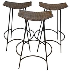 Three Arthur Umanoff Iron and Rattan Bar Stools  | From a unique collection of antique and modern stools at https://www.1stdibs.com/furniture/seating/stools/
