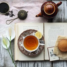 Tea with lemon.  Photography by Annetta Bosakova via flickr. Tea and a good book, that really suits me!